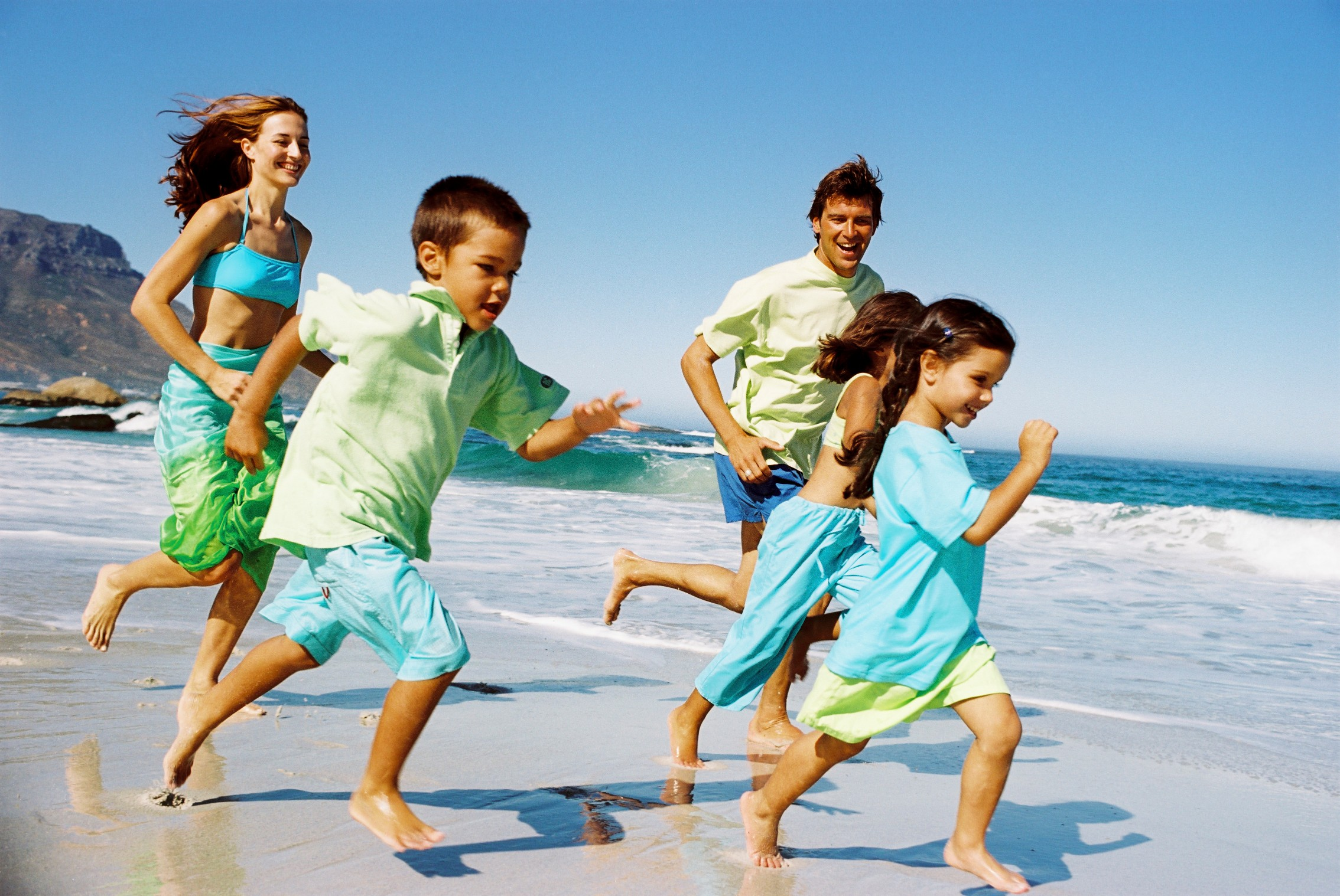 Happy Family Running Beach