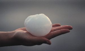 hands with ice ball